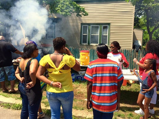 The air was filled with the smells of hot dogs, hamburgers and beans as friends and family of the late Jerame C. Reid celebrated his birthday.
