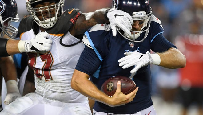 Titans quarterback Blaine Gabbert (7) is tackled by face mask by Buccaneers defensive end Vinny Curry (97) in the second quarter of a preseason game at Nissan Stadium Saturday, Aug. 18, 2018, in Nashville, Tenn.