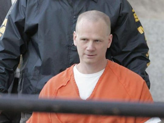 Dustin Honken is led by US Marshals into the Federal Courthouse in Cedar Rapids prior to his sentencing on Tuesday, Oct. 11, 2005. A federal jury in 2004 chose the death penalty for the former methamphetamine dealer after finding him guilty of murder and conspiracy in the 1993 killings of two informants and the girlfriend of an informant and her two daughters.
