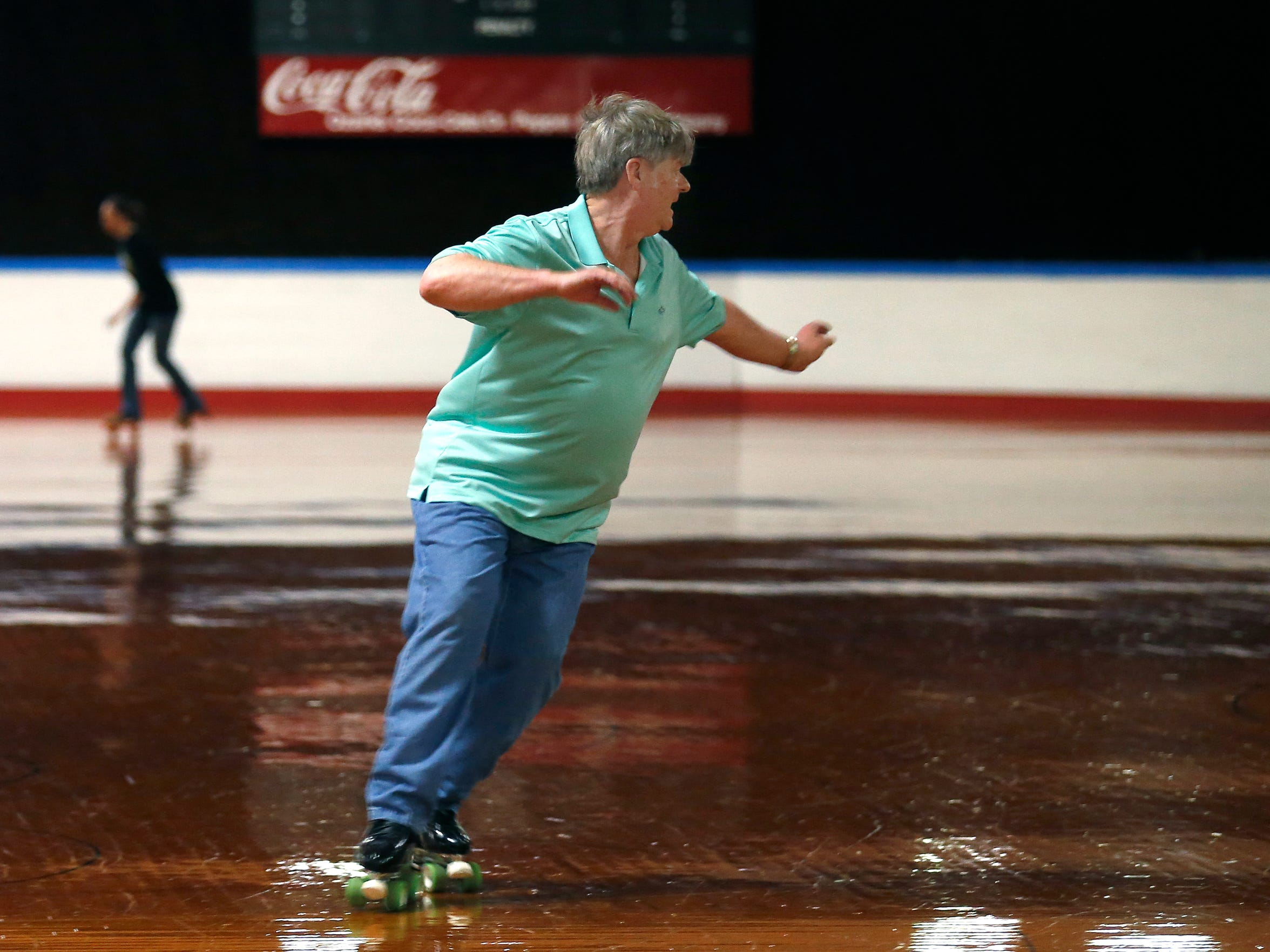 Doyle Crews, 62, who's knows as Dancing Doyle at the skate rink, dances to the music as he roller skates around Skateland on Sunday, Feb. 21, 2016.