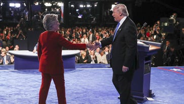 Democratic presidential nominee Hillary Clinton shakes hands with Republican presidential nominee Donald Trump after the presidential debate at Hofstra University in Hempstead, N.Y., Monday, Sept. 26, 2016.