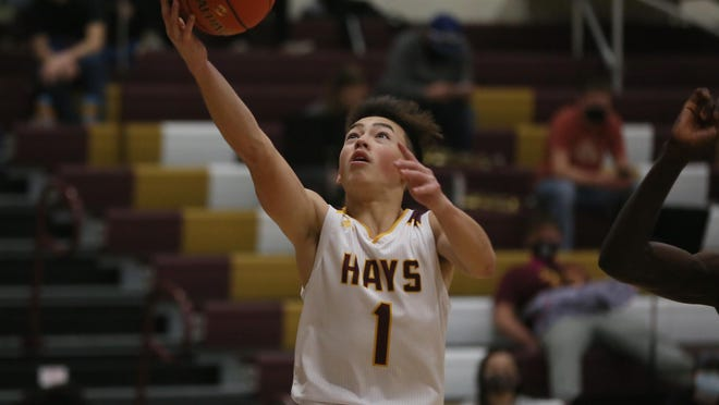 Hays High's Jason Krannawitter lays it in during the Indians' 71-29 win over Life Prep on Friday at HHS.