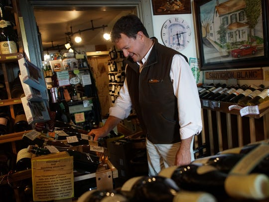 Regular customer Vince Moro shops for wine at Collier's Centreville Fine Wine, Spirits & Beer.