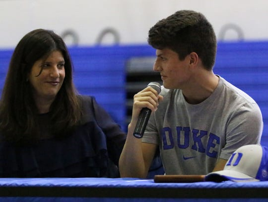 Community School of Naples senior Matthew Eklund thanks his mom prior to signing as a preferred walk-on with Duke University during National Signing Day on Wednesday.