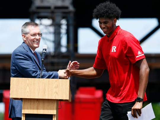 Director of Athletics, Pat Hobbs introduces Myles Johnson, power forward for the Rutgers basketball team and engineering student during the placement of the final piece of structural steel at the topping off ceremony at the 307,000 square foot Rutgers RWJBarnabas Health Athletic Performance Center. June 3, 2018. Piscataway, NJ