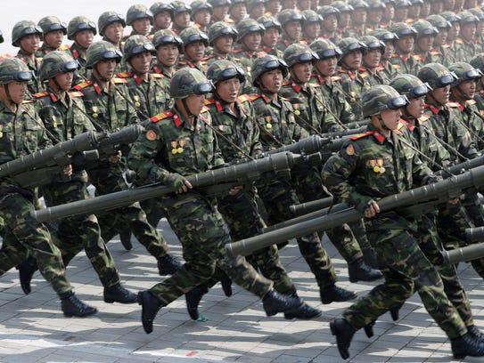 Soldiers march across Kim Il Sung Square during a military
