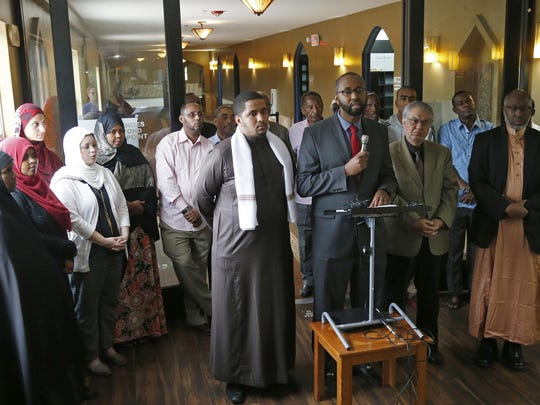 Jaylani Hussein, center, director of the Council on American-Islamic Relations-Minnesota, discusses the Somali community's concerns about the Countering Violent Extremism program in Minneapolis.