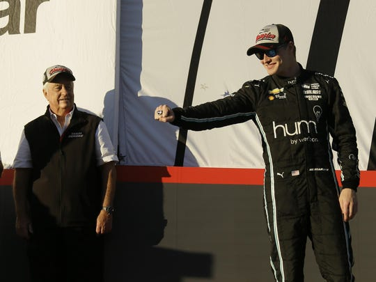 Josef Newgarden, here with team owner Roger Penske, is the IndyCar points leader.
