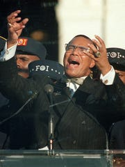 In this Oct. 16, 1995, Nation of Islam leader Louis Farrakhan addresses the Million Man March from Capitol Hill in Washington, D.C.