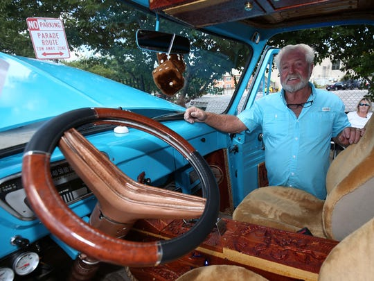 Eddie Thomas is seen here with his customized 1955 Ford F100 during the Route 66 festival in downtown Springfield on August 13, 2016.