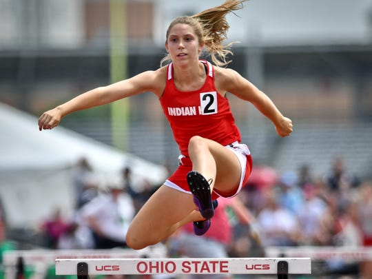 Indian Hill's Ellie Podojil clears a hurdle during the finals of the girl's division 2 300 meter hurdles Saturday, June 2nd at the State Track and Field Championships at Jesse Owens Memorial Stadium