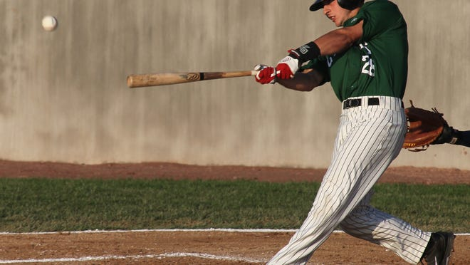 Designated hitter Paul DeJong belts a second-inning home run for the Woodchucks last season at Athletic Park in Wausau.