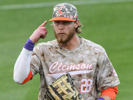 Clemson junior first baseman Seth Beer (28) points