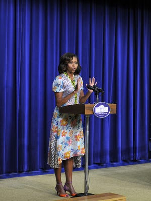 First Lady Michelle Obama welcomes school kids to screening of 'The Powerbroker: Whitney Young's Fight for Civil Rights' at the Eisenhower Executive Office Building.