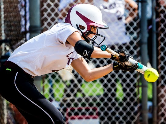 Caravel's Samantha Esper bunts her way on base during Caravel's 10-0 win over Charter in their semi-final game of the DIAA State Softball tournament at Caravel Academy on Thursday afternoon.