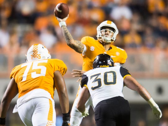 Tennessee quarterback Jarrett Guarantano (2) makes a throw before Southern Miss linebacker Paxton Schrimsher (30) tackles him during a game between Tennessee and Southern Miss at Neyland Stadium in Knoxville, Tennessee, on Saturday, Nov. 4, 2017.