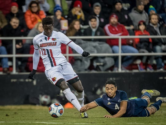 Louisville's Cherif Dieye (12)plays against Akron's Niko De Vera (4) during the NCAA Mens Quarterfinal Soccer Match played at  Lynn Stadium in Louisville, Kentucky, Friday, December 1, 2017