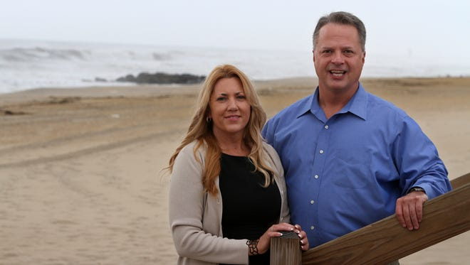 Lisa Kelly, president of Ashore Property Management, and Drew Barile, CEO, pose on the beach in Spring Lake.