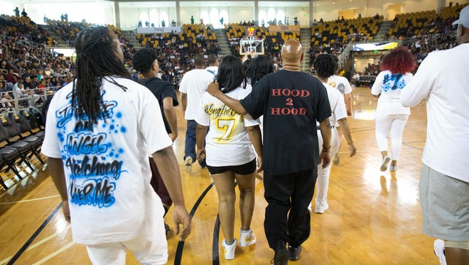 The family of Dequante Hobbs Jr. is welcomed onto the court at Xavier University Convocation Center for Master P to recognize them. June 29, 2017.