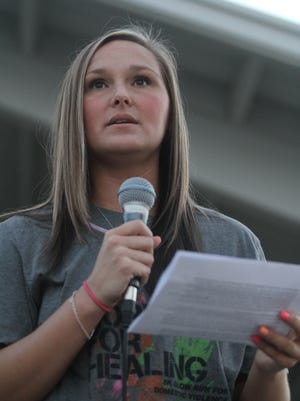 Tiffany Allison describes some of her experiences as a survivor of domestic violence. The Warren County Coalition Against Domestic Violence hosted the second Hope for Healing 5K Glow Run Sept. 17 starting at Indianola High School. The event included a one-mile fun run.