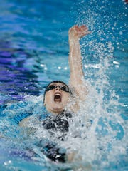 Ames' Sophie Sorenson competes in the 100 yard backstroke at the Iowa high school girls state swimming meet on Saturday, Nov. 4, 2017, in Marshalltown.