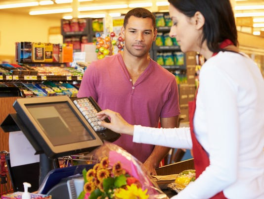 Customer Paying For Shopping