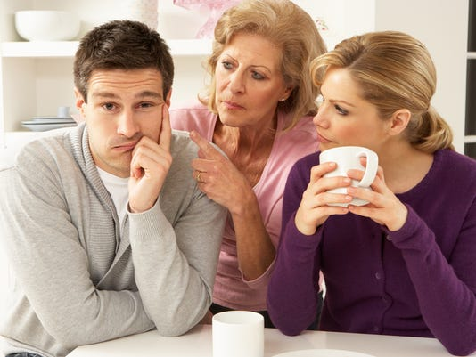 Older woman in between young woman and young man