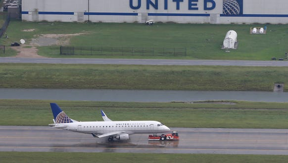A United Airlines plane is towed at Houston's Bush Intercontinental Airport on Tuesday, Aug. 29, 2017. The airport was closed to commercial service at the time because of Harvey. (Photo: David J. Phillip, AP)