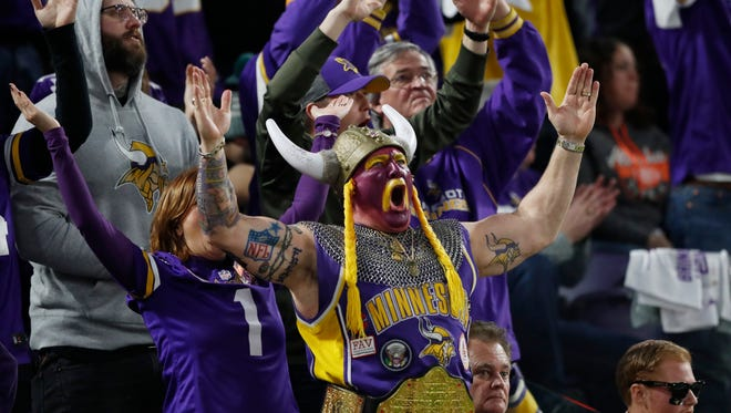 Minnesota Vikings fans cheer during the first half of an NFL divisional football playoff game against the New Orleans Saints in Minneapolis, Sunday, Jan. 14, 2018.
