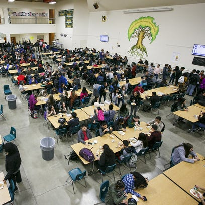 Students stream into the cafeteria for the first of