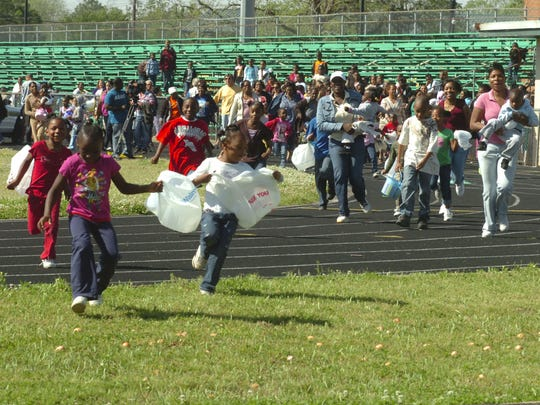 4/12/2009 A3 Children rush onto the Peabody Magnet