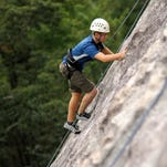 A WCU student takes part in a Base Camp Cullowhee rock climb. Western Carolina University is the championship round to be named Top Adventure College.