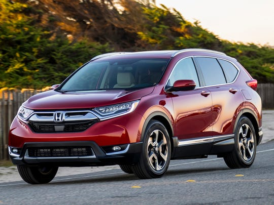 A red 2018 Honda CR-V, a compact crossover SUV