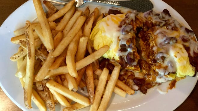 On Napa-Sonoma North's new breakfast menu, an omelet made with house chili is finished with crème fraîche.