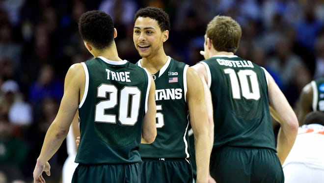 Michigan State guard Bryn Forbes (5) celebrates with guard Travis Trice (20) and forward Matt Costello (10) during the second half against Virginia.