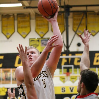 Paint Valley's Dylan Swingle shoots over two defenders