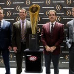College football playoff coaches from left; Bob Stoops, of Oklahoma, Dabo Swenney, of Clemson, Nick Saban, of Alabama and Mark Dontonio, of Michigan St., pose with the championship trophy after a news conference the college football awards at the College Football Hall of Fame Thursday, Dec. 10, 2015, in Atlanta. Oklahoma and Clemson will meet in the Orange Bowl and Alabama and Michigan St. will play in the Cotton Bowl. (AP Photo/John Bazemore)