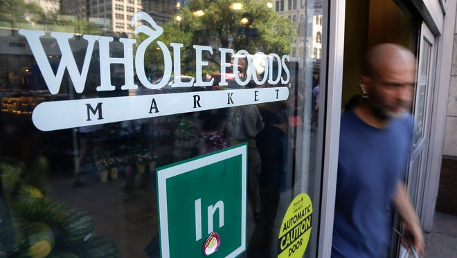 In this June 24, 2015, file photo, a shopper leaves a Whole Foods Market store in Union Square, in New York. Whole Foods on Monday, Feb. 29, 2016, announced that it was recalling Maytag Raw Milk Blue Cheese because of possible listeria contamination.