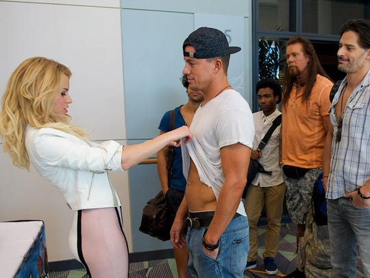 "Elizabeth Banks, from left, Channing Tatum, Adam Rodriguez, Donald Glover, Kevin Nash, Joe Manganiello and Jada Pinkett Smith are seen in a scene from ""Magic Mike XXL."""