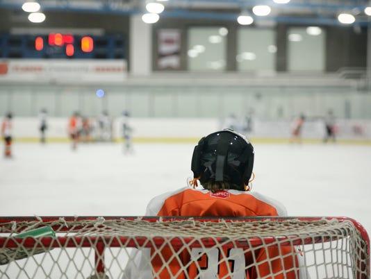 Child Hockey Goalie in Net