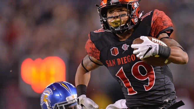 San Diego State running back Donnel Pumphrey, who is on pace to break the NCAA's all-time rushing record, breaks a tackle while running for a touchdown in an Oct. 21 win over San Jose State at Qualcomm Stadium in San Diego.
