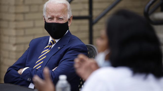 Democratic presidential candidate, former Vice President Joe Biden, left, listens as Carlette Brooks, owner of Carlette's Hideaway, a soul food restaurant, talks during a meeting with small business owners, Wednesday, June 17, 2020, in Yeadon, Pa.