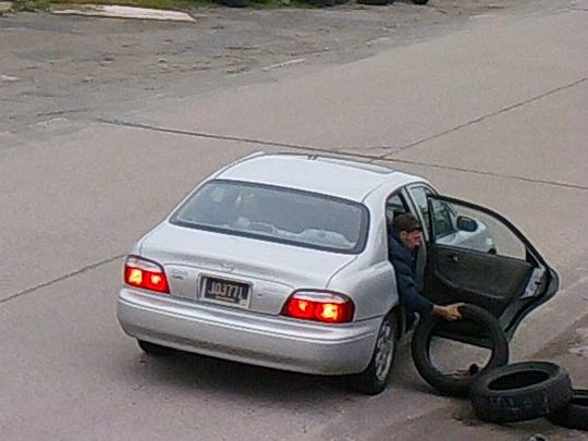 This person was captured by cameras unloading tires from the back of his vehicle onto the 900 block of S. Walnut St.