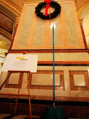 The Festivus pole stands in the rotunda at the Illinois