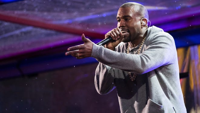 Kanye West performs during the World AIDS Day (RED) concert In Times Square in New York on Dec. 1, 2014. West, Sam Smith, Janet Jackson and the Who are some of the A-Listers set for the iHeartRadio Music Festival this fall.