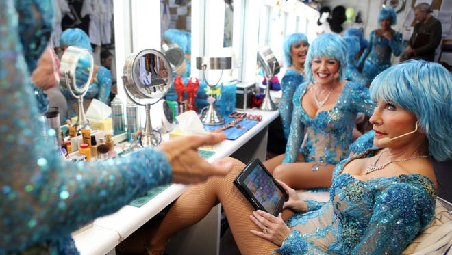 Cast Member Terri Olsen, 57, takes quick break to play Candy Crush minutes before taking the stage at the Palm Springs Follies on Thursday, May 1, 2014 in Palm Springs, Calif.