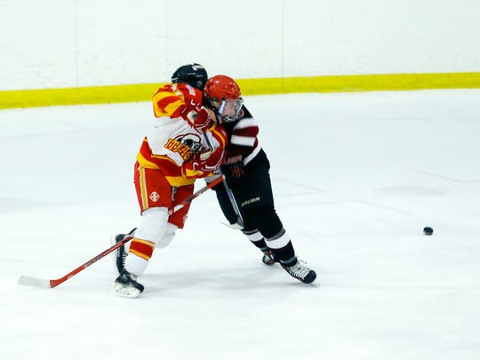 Ithaca's Brandon Shirley collides with a Syracuse defender during their game Tuesday afternoon. Syracuse won, 6-2.