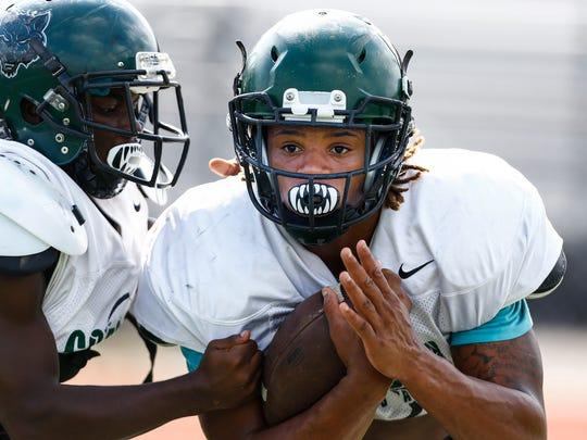 Cordova High School running back Jeremy Banks (right)