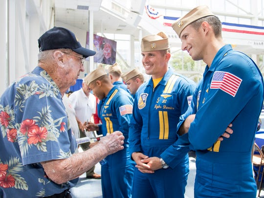 Pearl Harbor survivor Frank Emond chats with Blue Angels pilots  Lt. Tyler Davies and Lt. Brandon Hempler at the National Naval Aviation Museum on Wednesday, May 16, 2018.  Emond will be celebrating his 100th birthday on Monday, May 21st.