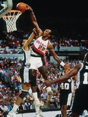 Portland Trail Blazers guard Clyde Drexler dunks the ball against the San Antonio Spurs at Memorial Coliseum.
